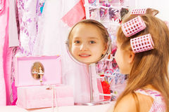 Beautiful small girl reflecting in round mirror Royalty Free Stock Image