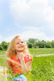 Beautiful small girl's portrait in green park Stock Image