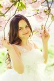 Small smiling girl in blossom stock photos