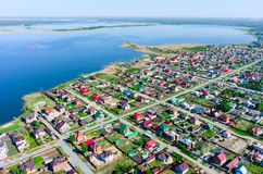 Beautiful small green village near lake from above Royalty Free Stock Images
