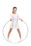 Beautiful small gymnastic girl. In white clothes, with hoop in hand, on white background Royalty Free Stock Image