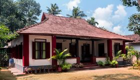 Beautiful Small House In Kerala With Clear Sky Background Stock