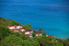 Beautiful small houses near the tropical ocean Stock Photo