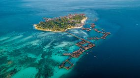 Beautiful small island near Borneo with atoll