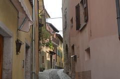 Tipical italian street with old houses and tradition. Beautiful small italian street at the Garda Lake with excellent wine and full of tradition Stock Photography