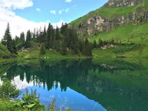 A beautiful small mountain lake stock photo