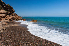 Beautiful small pebble beach on the coast Spain Stock Image