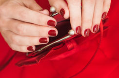 Beautiful small red female purse in hands Royalty Free Stock Photos