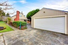Beautiful small siding house with garage Stock Photo