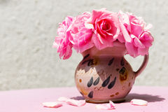 Beautiful small vase with pink flowers Royalty Free Stock Photo