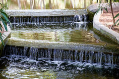 Beautiful small waterfall with cascades in Reina Sofia Park, Guardamar del Segura. Valencia, Spain. Stock Photos