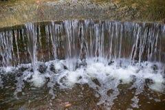 Beautiful small waterfall with cascades in Reina Sofia Park, Guardamar del Segura. Valencia, Spain. Royalty Free Stock Photo