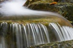 Beautiful small waterfall on a rocky stream Stock Photo