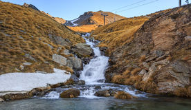 Beautiful small waterfall on top of the mountain Royalty Free Stock Images