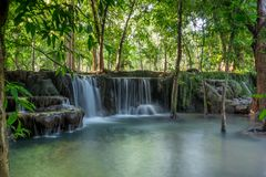 Beautiful small waterfalls hidden in the tropical jungle of Thailand. Royalty Free Stock Images