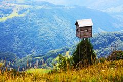 Beautiful small wood house in the Alps Stock Image