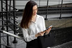 Beautiful smart business woman looking at Tablet stock photos