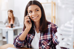 Beautiful smart woman talking to someone on phone Royalty Free Stock Images