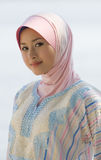 Beautiful smile. Confident and beautiful smile of the muslim young girl Stock Photo