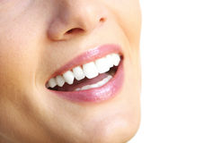 Beautiful smile. A close up of a female beautiful smile over white background Royalty Free Stock Photos