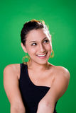 Beautiful smile. Alluring smile of a young woman in black single strap top Stock Photography