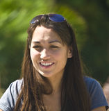 Beautiful Smile. A Chinese American smiles at her friend Royalty Free Stock Photo