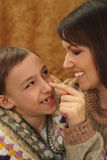 Beautiful smile Caucasian mama with her son Royalty Free Stock Photos