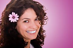 Beautiful Smile with a flower. Portrait of beautiful brunette woman smiling, with a flower Stock Photography