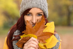 Beautiful smile girl hidden behind the leaves Stock Photos
