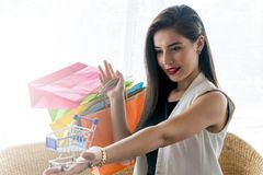 Beautiful smile girl holding colorful shopping bag. And credit card Stock Photos
