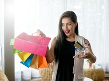 Beautiful smile girl holding colorful shopping bag. And credit card Royalty Free Stock Images