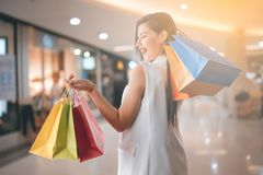Beautiful smile girl holding colorful shopping bag. And credit card Stock Photo