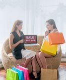 Beautiful girl holding colorful shopping bag. Beautiful smile girl holding colorful shopping bag surprising Sale eighty percent off Stock Photography