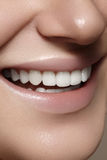 Beautiful smile with whitening teeth. Dental photo. Macro closeup of perfect female mouth, lipscare rutine Stock Photos