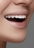Beautiful smile with whitening teeth. Dental photo. Macro closeup of perfect female mouth, lipscare rutine Stock Images