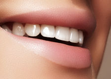 Beautiful smile with whitening teeth. Dental photo. Macro closeup of perfect female mouth, lipscare rutine Stock Image