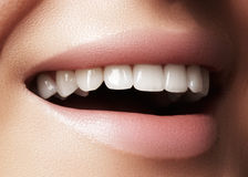 Beautiful smile with whitening teeth. Dental photo. Macro closeup of perfect female mouth, lipscare rutine. Macro happy female smile with healthy white teeth Royalty Free Stock Image