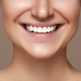 Beautiful smile with whitening teeth. Dental photo. Macro closeup of perfect female mouth, lipscare rutine stock photography
