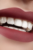 Beautiful smile with whitening teeth. Perfect fashion lips makeup Stock Photo