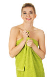 Beautiful smile woman after bath or spa. Beautiful smile woman after bath or spa, covered with green towel Royalty Free Stock Photography