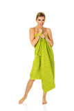 Beautiful smile woman after bath or spa. Beautiful smile woman after bath or spa, covered with green towel Royalty Free Stock Images