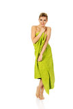 Beautiful smile woman after bath or spa. Beautiful smile woman after bath or spa, covered with green towel Stock Photo