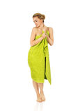 Beautiful smile woman after bath or spa. Beautiful smile woman after bath or spa, covered with green towel Stock Image