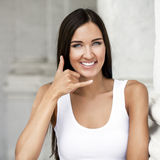 Beautiful smile woman making a call me gesture. Beautiful woman making a call me gesture Royalty Free Stock Photography