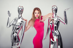 Beautiful smile woman in pink evening dress on background of man Stock Photography