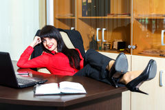 Beautiful smile woman relax in a office. Beautiful smile woman relax at the table in a office Royalty Free Stock Image