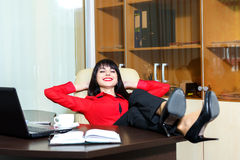 Beautiful smile woman relax in a office Royalty Free Stock Image