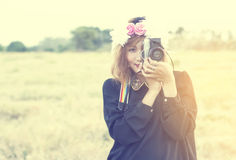 Beautiful smile woman in wreath of flowers with retro camera at Royalty Free Stock Photos