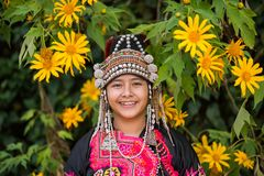 Beautiful smile young hill tribe girl in sunflowers garden. stock photo