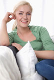 Beautiful smile young woman with white pillow Stock Photography